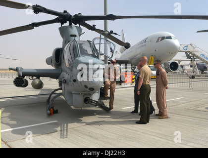 U.S. Marine Corps Capt. Joseph Fry explains the capabilities of the AH-1Z Cobra during the 2013 Dubai Airshow at the Dubai World