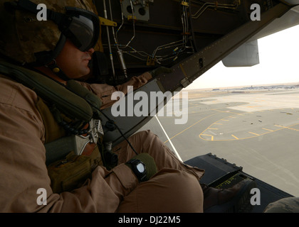 U.S. Marine Corps Sgt. Devon Morris looks down at the other aircraft at the 2013 Dubai Airshow at the Dubai World - Stock Photo