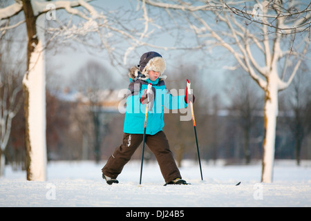 Cute little boy skiing on cross - Stock Photo