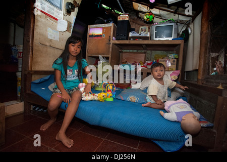 Children Disfigured family crippled poor Bali poverty challenged extreme poor bellow standard Indonesia 29 house - Stock Photo