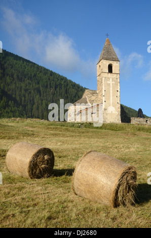 Hay Bales in front of Eglise St-Pierre d'Extravache Bramans Haute Maurienne Valley Savoie France - Stock Photo