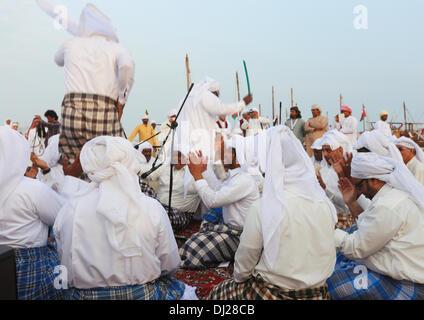 Doha, Qatar, Nov 19, 2013:  A Qatari folk group performs traditional songs of the country's fishing community at - Stock Photo