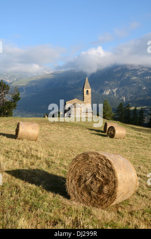 Church Chapel or Eglise St-Pierre d'Extravache and Vanoise National Park in Background French Alps Savoie France - Stock Photo