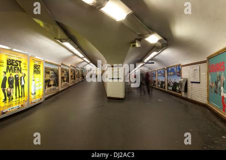 Motion blurred people walking in Metro tunnel in Paris. - Stock Photo