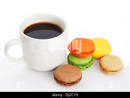 Delicious and colorful macaroons and a cup of black coffee on white - Stock Photo