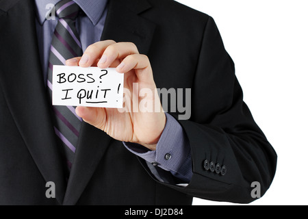 Man hand holding a business card stating I quit in bold! - Stock Photo