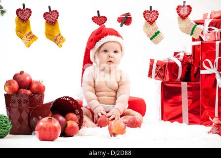 Cute little girl in Santa hat - Stock Photo