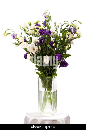 Bouquet of eustoma flowers in vases, isolated on white - Stock Photo