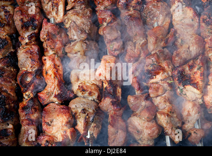 Background of grilled shish kebabs on skewers - Stock Photo