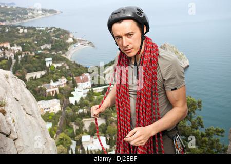 Climber on a top of a mountain - Stock Photo