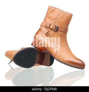 Pair of ankle-high male boots over white - Stock Photo