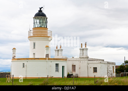 Lighthouse on the Moray Firth at Chanonry Point on the Black Isle in the Scottish Highlands - Stock Photo