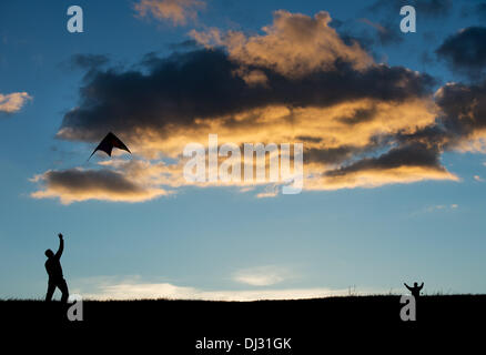 Dresden, Germany. 9th Nov, 2013. A man and a boy are letting their kite fly in the Autumn sky on the Truemmerberg - Stock Photo