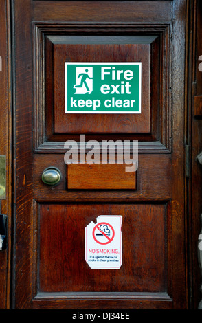 London, England, UK. Fire exit / no smoking sign - Stock Photo