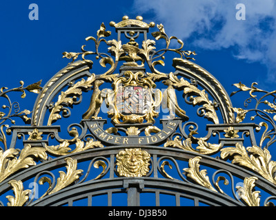 Ornate gilded entrance gates to Clandon Park with Onslow family crest and motto 'Semper Fidelis'  'Always Faithful' - Stock Photo