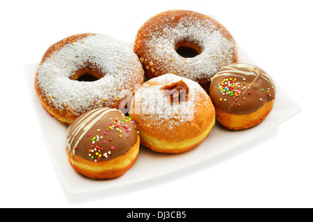 Festive donuts in different sizes. White background. - Stock Photo