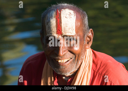 Sadhu, Indian holy man and renunciant and devotee of Lord Vishnu shown here with the style of adornment on his forehead - Stock Photo