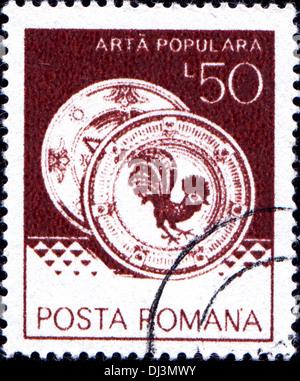 ROMANIA - CIRCA 1982: A stamp printed in Romania shows Ceramic plates from Horezu, folk art series, circa 1982 - Stock Photo