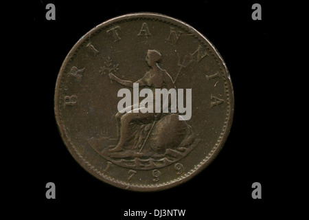Old British Coin Isolated On A Black Background - Stock Photo