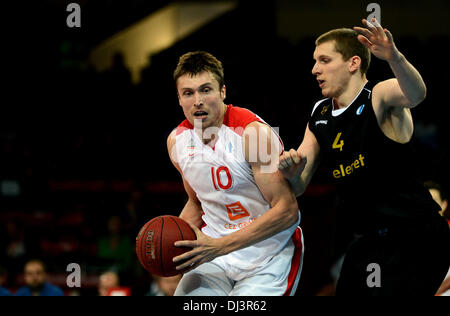 Veselin Petrovic of Nymburk, left, fights for the ball with Jared Berggren of Ostende during the European Men's - Stock Photo