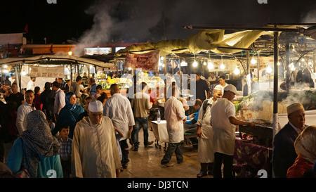 Open air restaurants at the Djemaa El Fna market at night, Medina, Marrakech, Morocco, North Africa - Stock Photo
