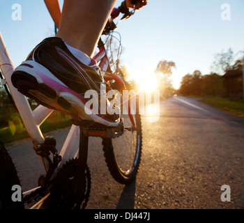 foot on pedal of bicycle - Stock Photo