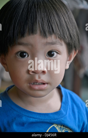 Thai child with unusual large and wide eyes. Thailand S. E. Asia - Stock Photo