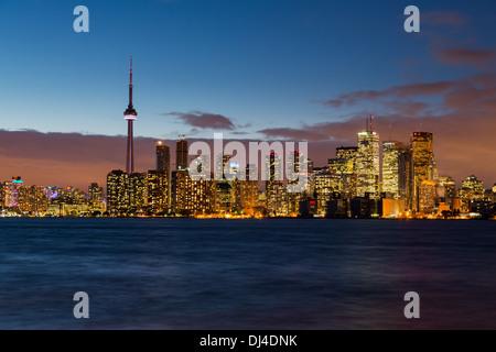 Toronto skyline across Lake Ontario, Canada at night / dusk