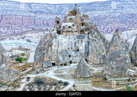 Rock house in the red valley Turkey - Stock Photo