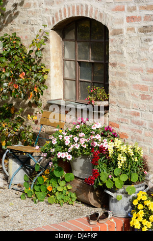 Old window decorated with flowers - Stock Photo