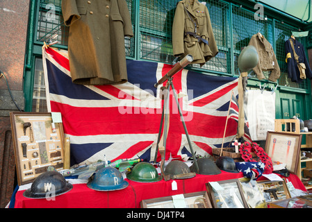 World War II memorabilia for sale on a stall at Portobello Road Market, Notting Hill, London, England, UK - Stock Photo