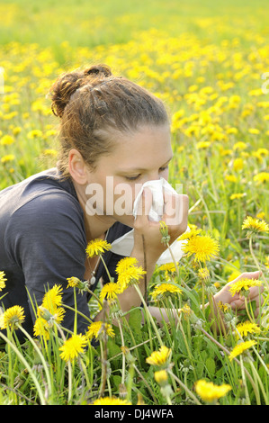 young woman with handkerchief on a meadow - Stock Photo