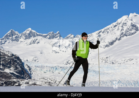 Nordic Skier Enjoying The Wide Open And Uncrowded Skiing In The Juneau Area, Mendenhall Glacier And Towers Beyond, - Stock Photo