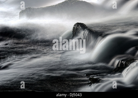 Flowing over the rocks - Stock Photo