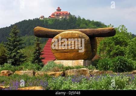 Wooden monument of a fried sausage, Germany - Stock Photo