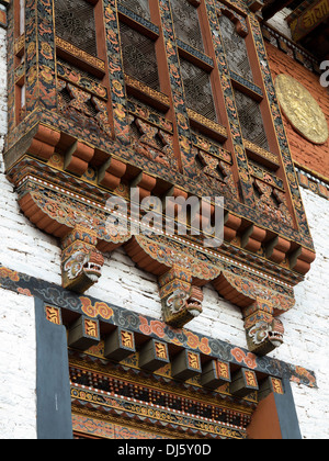 Bhutan, Punakha Dzong, decorated wooden window - Stock Photo
