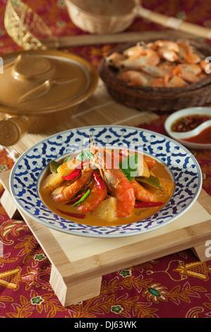 Thai prawn and pineapple curry. Kaeng Kua Sapparot. Food Thailand - Stock Photo