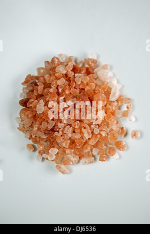 Himalayan pink salt on white background. - Stock Photo