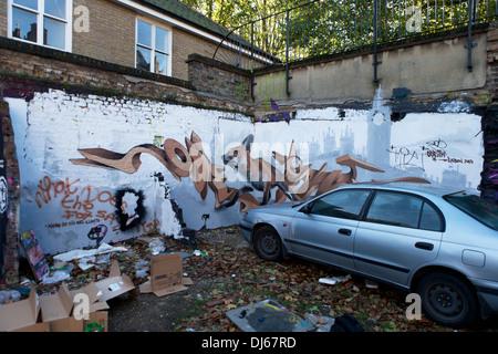 Street Art on a side street near Brick Lane, London, UK. - Stock Photo