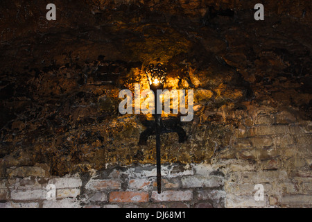 torch on the wall of an old castle Dubno, Ukraine - Stock Photo