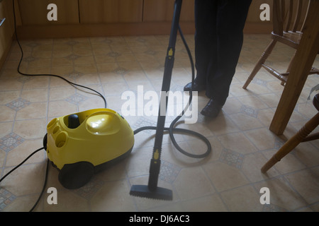 Close up steam cleaning kitchen floor with Karcher electrical ...