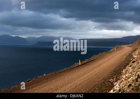 typical road in western fjords region near Bildudalur, Iceland - Stock Photo