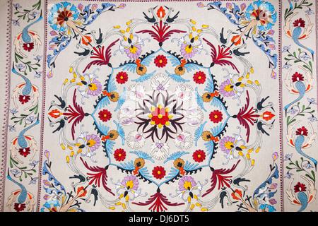 A 1961 Suzani textile from Tashkent, cotton machine embroidered silk, Museum of Applied Arts, Tashkent, Uzbekistan - Stock Photo