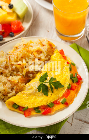 Homemade Organic Vegetarian Cheese Omelette with Onions and Peppers - Stock Photo