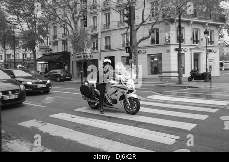 French Police officer on motorcycle in Paris, France, Europe - Stock Photo