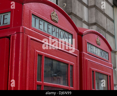 Two red telephone booths side by side in London, England. - Stock Photo