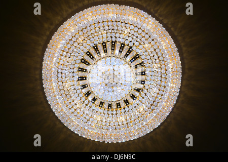 Contemporary glass chandelier hanging on the ceiling - Stock Photo