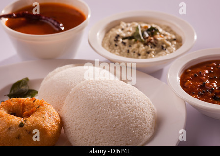 Idli Vada is a South Indian breakfast dish served with coconut chutney and sambar - Stock Photo