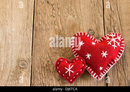 Christmas concept (decoration). Two red handmade hearts over rustic wooden background (texture) close up, horizontal. - Stock Photo