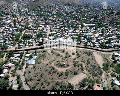 Aerial view of the border fence separating Nogales, Arizona from Nogales, Mexico June 1, 2010 in Nogales, AZ. - Stock Photo